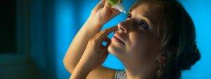 Woman Putting in Eye Drops, Eye Doctor in Parker, CO
